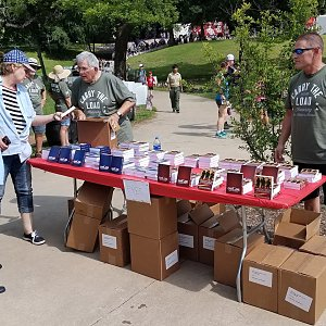 Strength for Service distributes 5,000 books at Memorial Day observance
