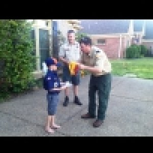 Cub Scout recovering from surgery advances in rank