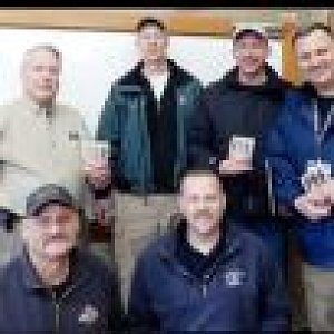Men give devotional books to first responders following mudslide