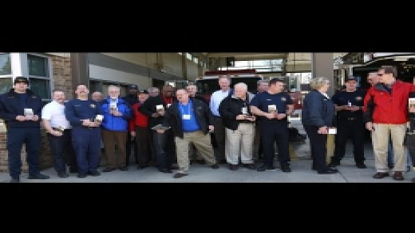 news um men give devotional books to firefighters 0