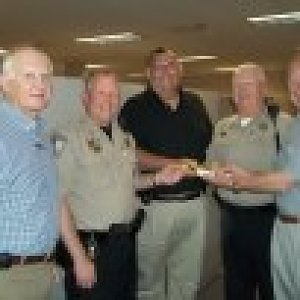 UM Men present copies of historic book of devotions to sheriff's department