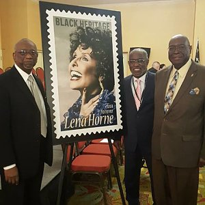 Leader of UM Men unveils postage stamp